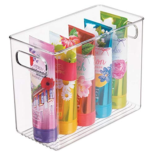 mDesign Slim Plastic Storage Container Bin with Handles - Bathroom Cabinet Organizer for Toiletries Makeup Shampoo Conditioner Face Scrubbers Loofahs Bath Salts - 5 Wide - Clear