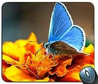 青い蝶のマウスパッドとオレンジ色の花、ゲーミング長方形のマウスパッド