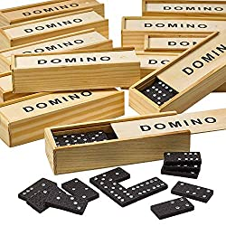 Dominoes packs in wooden cases with the lid slid open on one case and black dominoes on the table around it