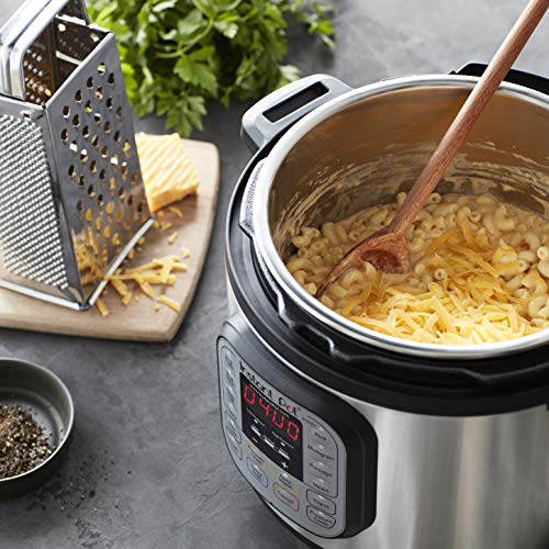 Instant Pot 7-in-1 Electric Pressure Cooker, with mac and cheese inside