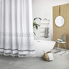 KEEPS WATER INSIDE -- NEW resin coating technology keeps water slide off the fabric shower curtain. No liner required. YOUR STYLE OUTSIDE -- This boho shower curtain with adorable white pom pom trim on the bottom. Pure white base color means that it ...