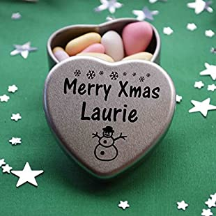 Merry Xmas Laurie Mini Heart Gift Tin with Chocolates Fits Beautifully in the palm of your hand. Great Christmas Present for Laurie Makes the perfect Stocking Filler or Card alternative. Tin Dimensions 45mmx45mmx20mm. Three designs Available, Father Christmas, Snowman and Snowflakes. They also make perfect Secret Santa Gifts.