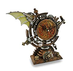 Designed in England by Alchemy Highly desired Steampunk/Mechanical free standing Clock High quality, hand painted, elabrate technical design Battery operated quartz movement inset - battery not included.