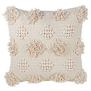 """Size: 18"""" Square Solid back, zipper closure Fiber: 100% cotton + Care: spot clean only This pom pom pillow should be sitting pretty for all those to adore, on your sofa, bed or chair. The back is a solid material and features a zippered closure."""