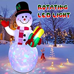 ◆Adorable Christmas Snowman inflatable decorations: When children or guests come to the door or garden, a 5-foot-tall inflatable snowman greets them with a gift, which will make your yards become unique and cute on Christmas! ◆Rotating Built-in LED C...