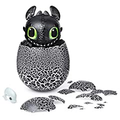 HATCH YOUR OWN BABY DRAGON: Agitate baby Toothless enough until he's ready to hatch! With light-up eyes you can see through his egg shell, rock it to make him growl; tap to hear him tap back; clap and he'll respond! Shake and tilt the egg until he st...