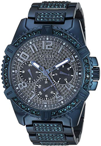 GUESS Relógio de pulseira enfeitada com cristal azul icônico de aço inoxidável com dia, data + militar de 24 horas/tempo Internacional. Cor: Azul (Modelo: U0799G6)