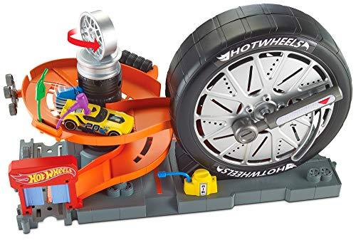 Hot Wheels Tienda de neumáticos supergiros, pista de coches de juguete (Mattel FNB17)