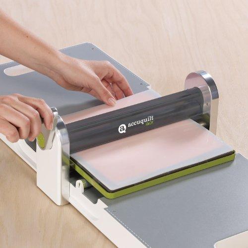 "AccuQuilt GO! Fabric Cutter Starter Set including the GO! Fabric Cutter, GO! Value Fabric Cutting Die, GO! 6"" x 12"" Cutting Mat, 20 Pg Pattern Book, and Die Pick."