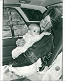 Vintage photo of Lady Sarah Spencer carying a baby