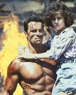 Arnold Schwarzenegger and Alyssa Milano in Commando 16x20 Poster