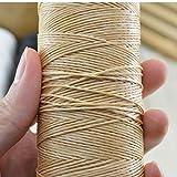 Bobina di filo cerato beige utilizzato per cucire pelle e cuoio come scarpe, borse, tende,...