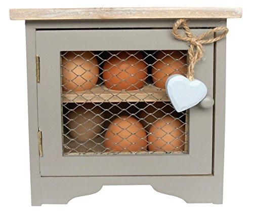 Gabinetto di uovo grigio francese con cuore appeso blu.