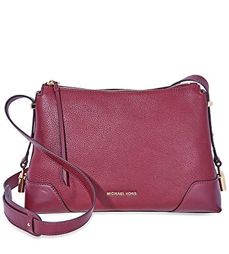 Oxblood pebbled leather Gold tone hardware Padlock charms Adjustable shoulder strap Interior:1 slip pocket, 1 zipped pocket
