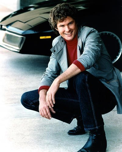 David Hasselhoff kneeling beside KITT