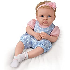 The 'Little Livie' So Truly Real Baby Doll is exclusive to The Ashton-Drake Galleries This Collector's Edition lifelike baby doll is handcrafted in our signature TrueTouch silicone that's velvety soft and flexible to feel just like a real baby and pe...