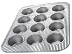 Cupcake and Muffin Pan has 12 standard size wells; commercial grade and heavy gauge aluminized steel with a lifetime warranty USA Pan baking pans feature Americoat which promotes quick release of baked-goods plus fast and easy clean up; wash with hot...