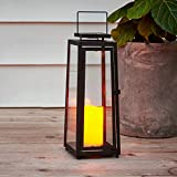 Large Outdoor Solar Lantern - 15 Inch Tall, Black Metal with Glass, Waterproof Flameless Pillar Candle Included, Dusk to Dawn Timer, Flickering LED Lights, Decorative Garden Lighting