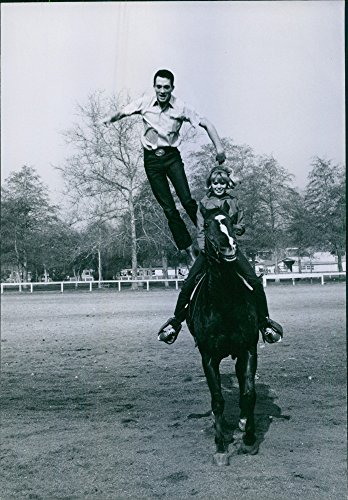 """Vintage photo of As Marta Kristen, 18, is piloting the horse, Buzz leaps off it. Marta is starring in """"Savage Sam"""", a Walt Disey production."""