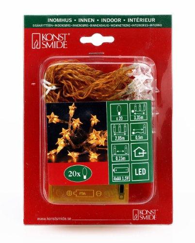 Konstsmide 1263-003 LED Lichterkette Sterne / 20 gelbe Dioden / Batterien: 4xAA 1.5V / bis zu 210h / transparentes Kabel