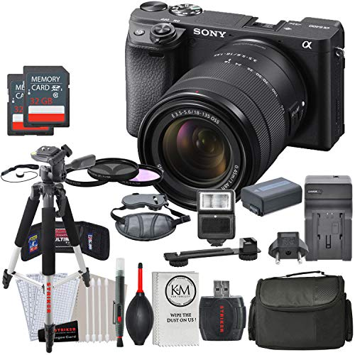 Sony Alpha a6400 Mirrorless Digital Camera with 18-135mm Lens (Black) and Striker Deluxe Bundle: Includes Filter Set, Extra Battery + Charger, Slave Flash, Large Bag, and Striker Starter Kit.