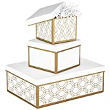 "Set of 3 gift boxes: 1 small measuring 4.75"" x 4.75"" x 3.94""; 1 medium measuring 6"" x 6"" x 4.22""; 1 large measuring 13"" x 9.5"" x 4.5"" Large and small boxes feature gold and white geometric designs while the medium box is white with gold edges. All ne..."