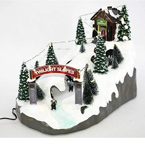 Villaggio di Natale innevato con Pista da Sci con Sciatori in Movimento su Pista ghiacciata, paesaggio con Luci LED e Musica Babbo Scenario Natalizio Parco Giochi Giostrina Carillon 36x27x24cm