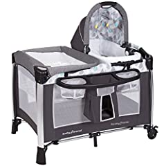 Portable Rock-A-Bye Bassinet can be used in stationary or rocking modes Foam mattress is ideal for naptime or playtime, large parent organizer for diaper changing essentials The bassinet can be easily removed to transform the nursery center into a pl...