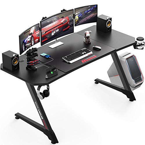 Vitesse 55 Inch Ergonomic Gaming Desk, Z Shaped Office PC Computer Desk with Large Mouse Pad, Gamer Tables Pro with USB Gaming Handle Rack, Stand Cup Holder and Headphone Hook, Carbon Fiber Black