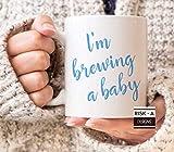 Regalo para futura madre Estoy preparando un regalo de revelación de embarazo para una madre azul bebé