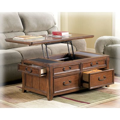 Signature Design by Ashley Woolwich Trunk Coffee Table with Lift Top - Accent Furniture -Framed...