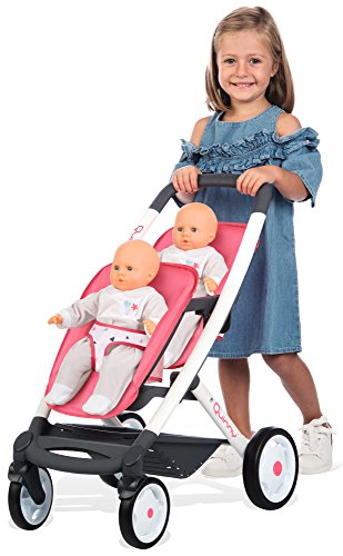 Smoby 253298 Pink Wheel Maxi-COSI & Quinny Twin Pushchair Baby Stroller | Stylish Dolls Buggy with Silent multidirectional Wheels & Ergonomic Handle | Ages 3 Smoby Your little one will absolutely love taking their baby doll for a walk with this super-cute dolls stroller. It's the most stylish way for them to push their dolls around town, and even better, it fits TWO (up to 42cm)dolls! Kids just love copying mum! You will treasure precious memories of leisurely park walks with your little one. The ergonomic handle is comfortable for kids. And the silent wheels and smooth multi-functional movement and steering make your strolls a pleasure! Your heart will melt watching your little one nurture and care for their 'babies' as they lovingly place them in this stylish stroller. Pushchairs are a brilliant way to improve leg strength and motor skills as they enjoying pushing their babies around. 3
