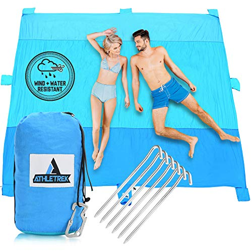 Extra Large Beach Blanket by Athletrek   Durable Sand Proof Water Resistant Beach Mat   Lightweight Quickdry 210T Ripstop Nylon   10' x 9' Outdoor Blanket for Picnics Travel Sports Camping