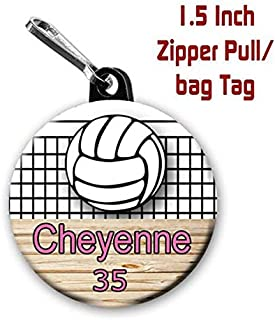 Two Volleyball zipper pull bag tags with 1.5 inch charms personalized with name and number