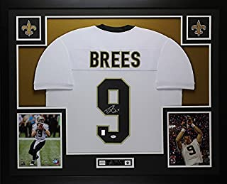 Drew Brees Autographed White New Orleans Saints Jersey - Beautifully Matted and Framed - Hand Signed By Drew Brees and Certified Authentic by Auto JSA COA - Includes Certificate of Authenticity