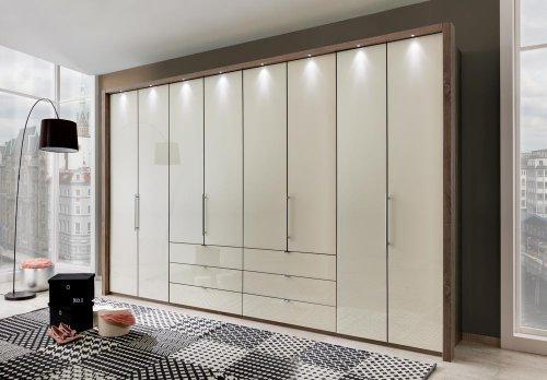 lifestyle4living Kleiderschrank mit Gleittüren-Panorama-Funktion in Trüffeleiche-Nachbildung,Glasfront in Magnolie,8 Türen und 6 Auszügen, Maße: B/H/T ca.400/216/58 cm