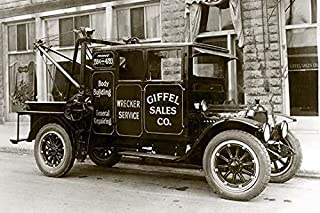 A photograph of an early tow truck Also called a wrecker is utility vehicle provided a wrecker service body building gener...
