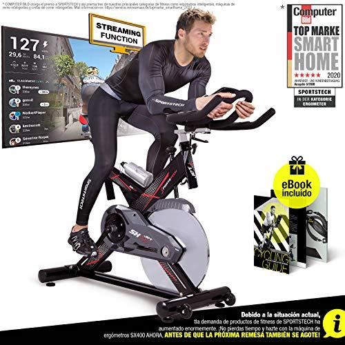 Sportstech Bicicleta estática Profesional SX400 - Marca de Calidad Alemana - Eventos en Video & Multiplayer App, Volante de 22Kg, Pulsómetro compatible, Correa silenciosa, hasta 150Kg Incl. eBook