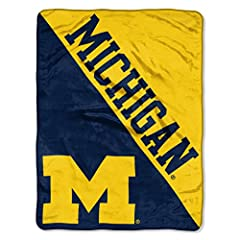 """Background is split diagonally between school's two primary colors; one half shows off the college or school's name and the other half shows off their team logo Soft and warm micro raschel fabric; decorative binding around all edges Measures 46""""W x 6..."""