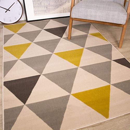 Alfombra amarilla y gris con diseño geométrico en tono mostaza