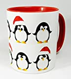 The Christmas Penguins Mug with red glazed handle and inner