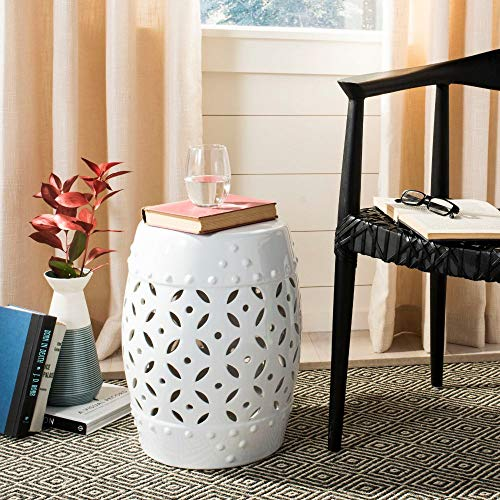 A garden stool for a side table is a great balcony furniture idea