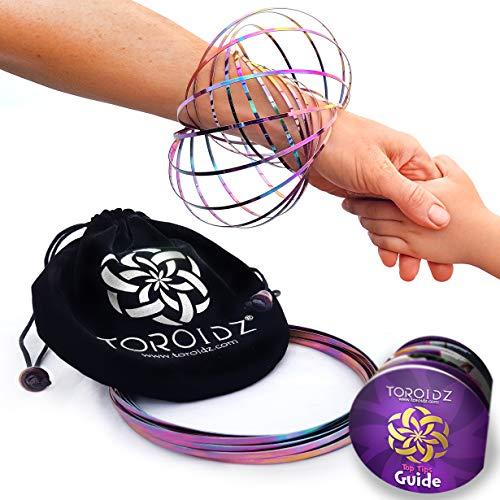 Toroidz ® Flow Ring (Regenbogen) + Samtbeutel - Wunderbares Magisches Spielzeug - 3D ARM Slinky - Wissenschaft, Zirkus, Magic Anti Stress Toy - Alle Altersgruppen
