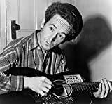 Woody Guthrie (1912-1967) Namerican Folk Singer Photographed Playing A Guitar That Has A Sticker Attached Reading This Machine Kills Fascists Photograph By Al Aumuller 8 March 1943 Poster Print by (1
