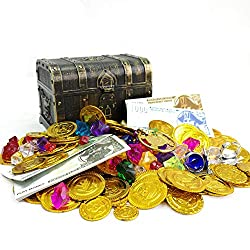 Small pirate's treasure chest with gold coins, toy jewels and play money surrounding it