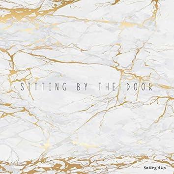 Sitting by the Door