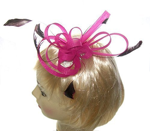 Large coiled net and feather fascinator on a clear comb in Pink