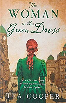 Paperback The Woman in the Green Dress Book