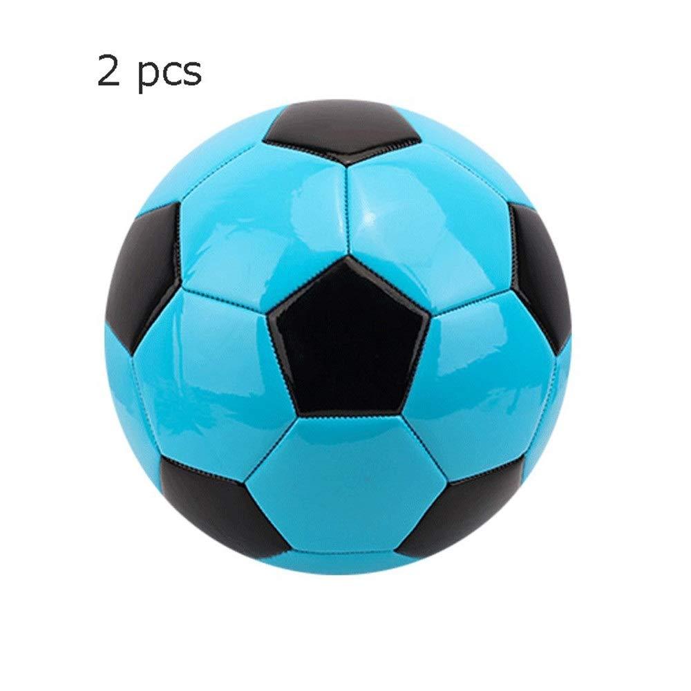 Los niños practican la pelota de fútbol Mini pelota de fútbol ...