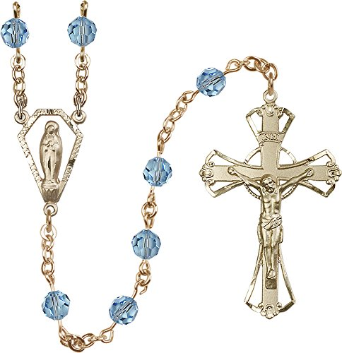 14Ct Gold Filled Rosary features 6mm Aqua Swarovski beads. The Crucifix measures 1 3/4 x 1 1/8. The centerpiece features a Miraculous medal.